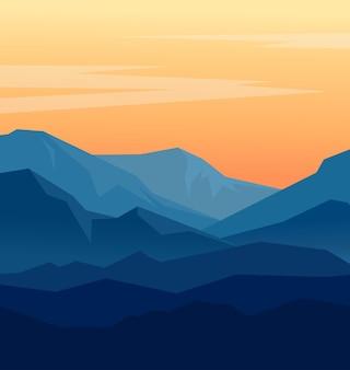 Paysage avec des silhouettes bleues de montagnes et ciel du soir orange.