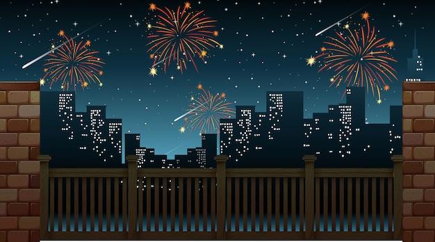 Paysage urbain avec feux d'artifice de célébration vue depuis le pont
