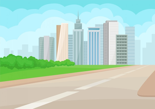 Paysage urbain avec route, immeubles de grande hauteur, herbe verte et buissons
