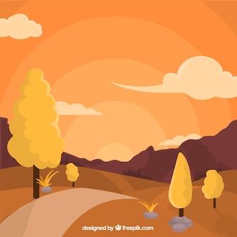 Paysage avec la voie et des arbres au coucher du soleil