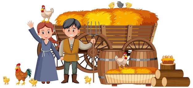 Paysans médiévaux de couples avec la botte de foin dans un chariot