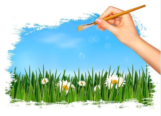 Peinture de la nature avec la main tenant un pinceau.