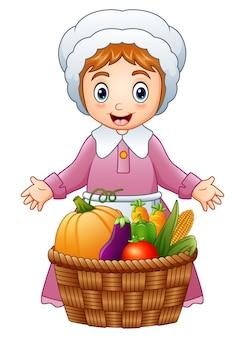 Pèlerin femme avec des fruits et légumes dans le panier en osier