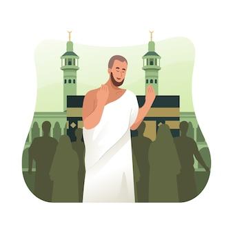 Pèlerin hajj en vêtements ihram priant devant la kaaba