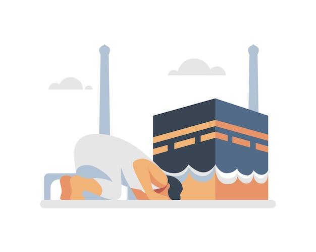 Un pèlerinage musulman prie devant l'illustration de la kaaba