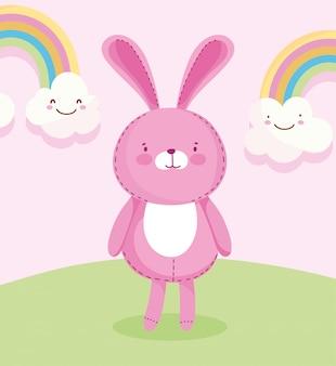 Peluche lapin rose avec des arcs-en-ciel