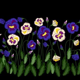 Pensées de broderie, ornement folklorique traditionnel avec des fleurs pour la conception de vêtements.