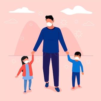 Père et enfants portant des masques médicaux à l'extérieur