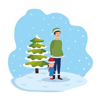 Père et fille dans le paysage de neige