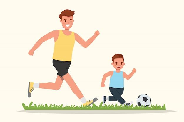 Père et fils jouant au football.