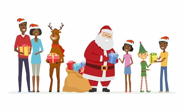 Le père noël avec des compagnons félicite la famille africaine - illustration isolée de personnages de dessins animés sur fond blanc. le père frost souriant avec des rennes et des elfes offre des cadeaux aux parents et aux enfants