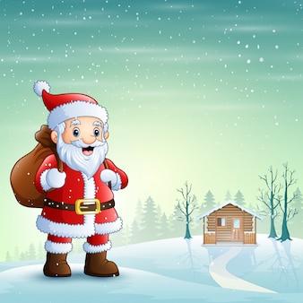 Père noël debout dans la neige avec un sac de cadeaux