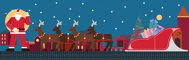 Père noël debout sur le toit avec rennes et traîneau et coffret cadeau