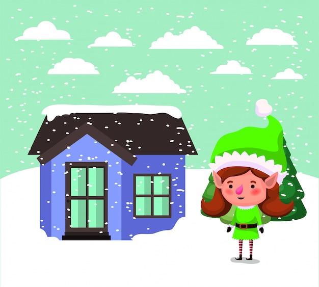 Père noël elfe avec maison dans la neige