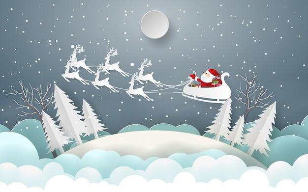 Le père noël offre aux enfants un cadeau joyeux noël et bonne année