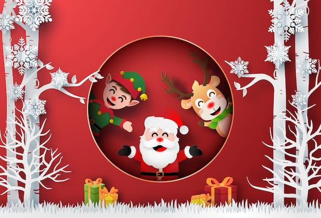 Père noël, rennes et elfes dans la forêt avec un cadeau de noël