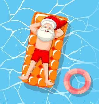Le père noël se détend dans le thème d'été de la piscine