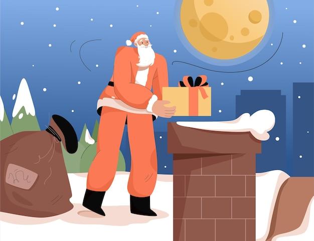 Le père noël tient des cadeaux et se tient près de la cheminée sur le toit