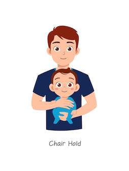 Père tenant un bébé avec une pose nommée prise de chaise