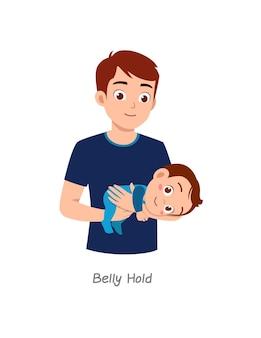 Père tenant un bébé avec une pose nommée prise du ventre
