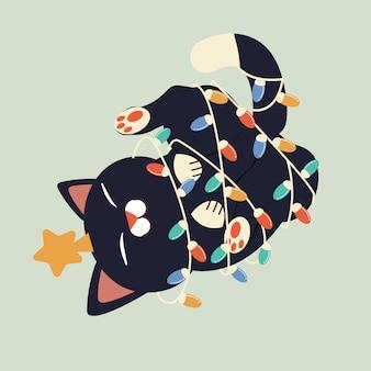 Le personnage de chat mignon joue avec une ampoule de noël et porte une étoile sur la tête.