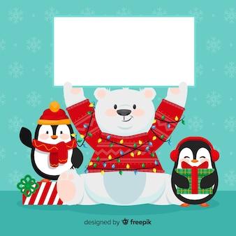 Personnage de Noël tenant une carte vide blanche
