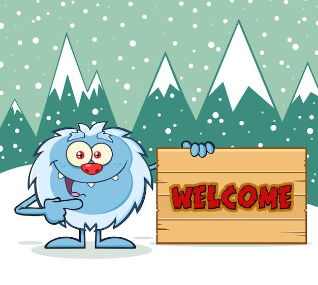 Personnage de dessin animé yeti pointant vers un signe de bienvenue