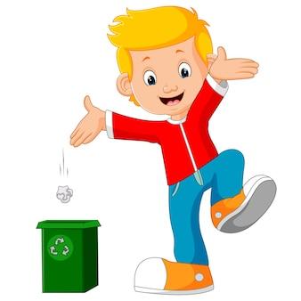 Personnage de garçon jette des ordures dans la poubelle