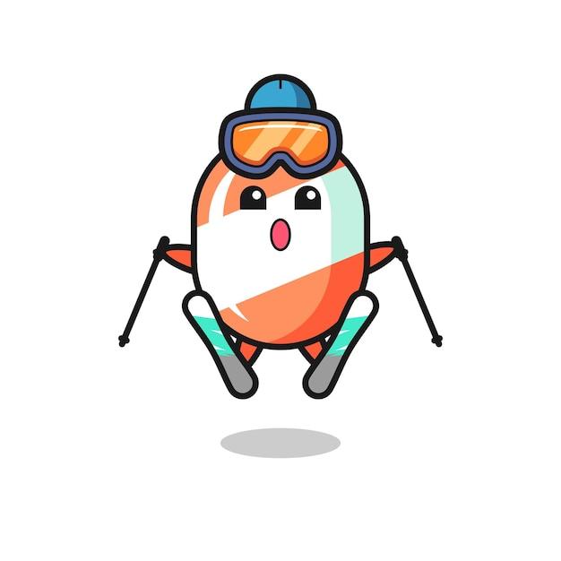 Personnage de mascotte de bonbons en tant que joueur de ski, design de style mignon pour t-shirt, autocollant, élément de logo