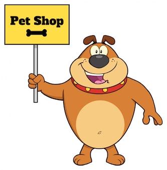 Personnage mascotte bouledogue brun tenant une pancarte avec texte animalerie