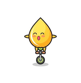 Le personnage mignon de goutte de miel fait du vélo de cirque, un design de style mignon pour un t-shirt, un autocollant, un élément de logo
