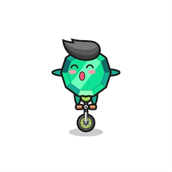 Le personnage mignon de pierres précieuses émeraude fait du vélo de cirque, un design de style mignon pour un t-shirt, un autocollant, un élément de logo