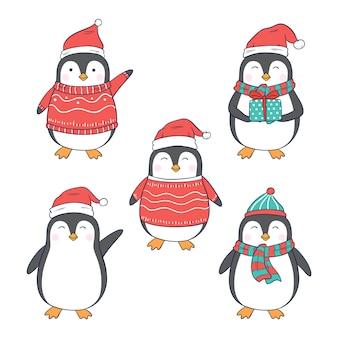 Personnage de pingouin de noël avec différents vêtements et style