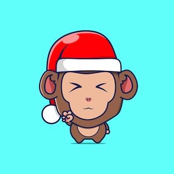 Personnage de singe mignon avec chapeau de noël