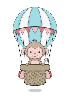 Personnage de singe mignon monté sur ballon à air chaud