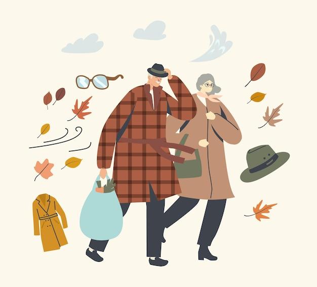 Personnages de couple senior se battre avec un vent fort, homme âgé et femme marchant par temps venteux