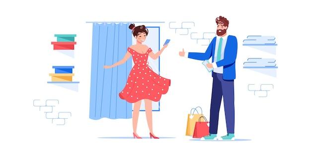 Personnages plats de dessin animé essayant une nouvelle tenue vestimentaire