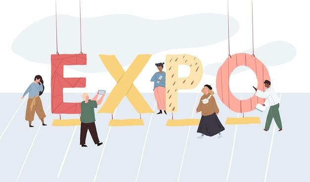 Personnages plats de dessin animé à l'expo de lettrage de gros texte