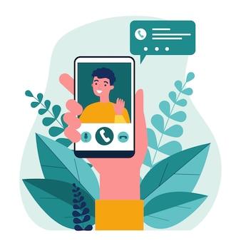 Personne tenant un smartphone et appelant via l'application mobile de chat vidéo