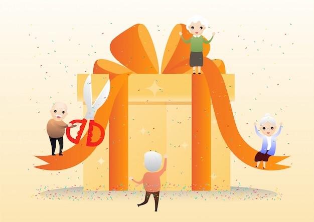Personnes âgées avec un grand coffret cadeau.