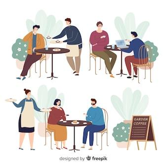 Personnes assises au café