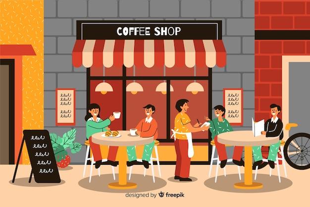 Personnes assises dans un café