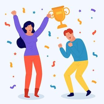 Personnes célébrant la réalisation d'un objectif et tenant un trophée