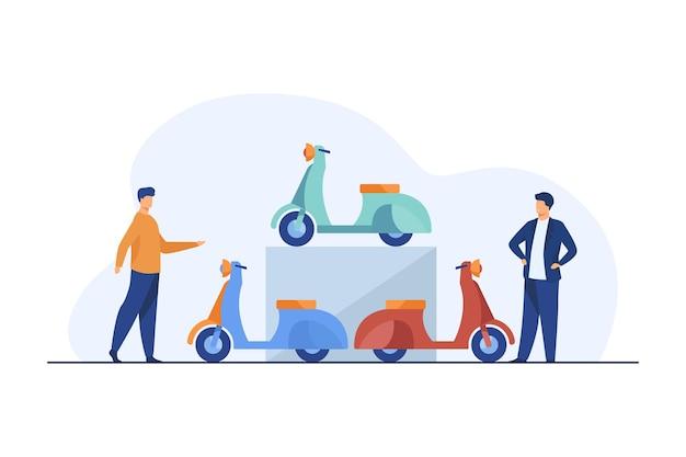 Personnes choisissant un scooter à louer