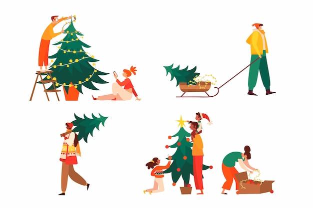 Personnes décorer la collection d'arbres de noël