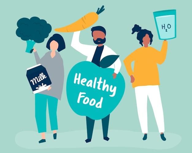 Personnes détenant des icônes d'aliments sains