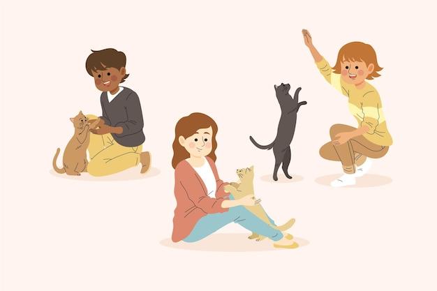 Personnes jouant avec leur thème d'animaux de compagnie