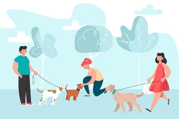 Personnes plates avec des animaux domestiques dans le parc