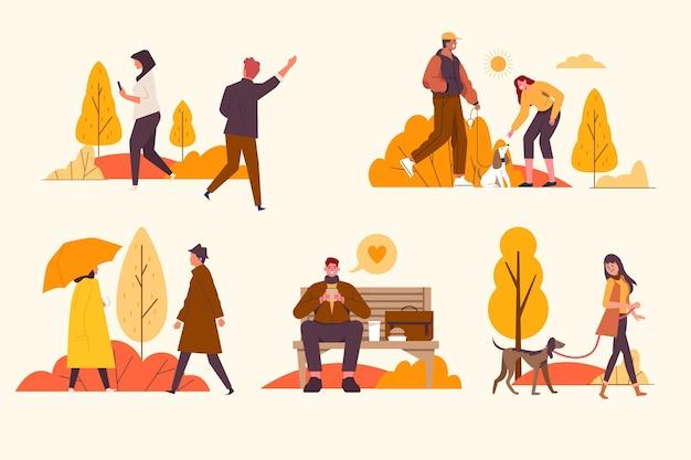 Personnes plates dessinées à la main dans un pack d'automne