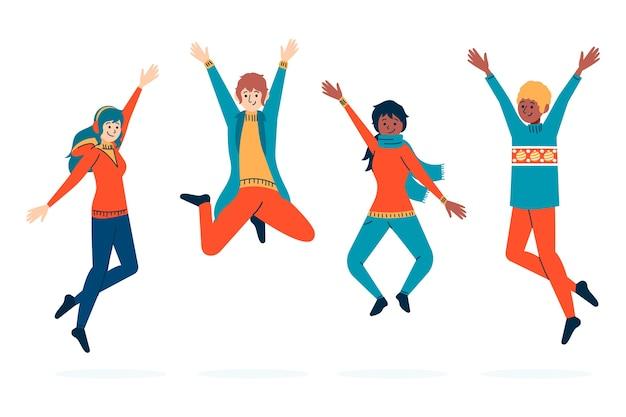 Personnes portant des vêtements d'hiver en sautant